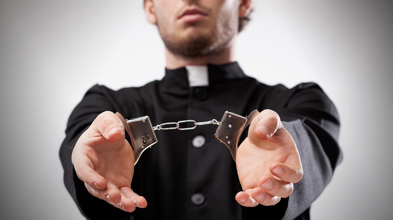 pedopriesthandcuffs